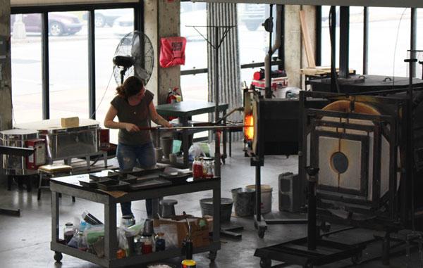 Glass artist firing work